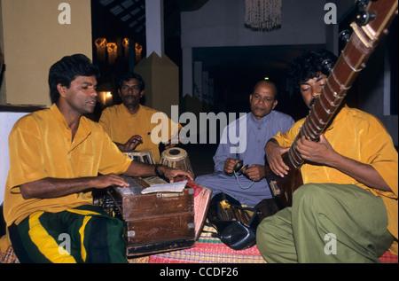 Traditional musicians playing in hotel, Dambulla, Sri Lanka - Stock Photo