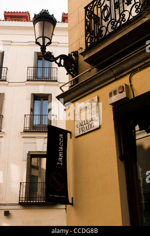 Detail of street sign and lantern calle muralla old for Calle del prado 9 madrid espana