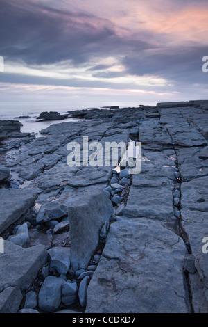 Sunset at Dunraven Bay, Glamorgan Heritage Coastline, Wales, UK. - Stock Photo