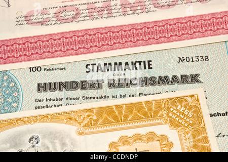 Detailansicht verschiedener alter Aktien | detail photo of some old shares - Stock Photo