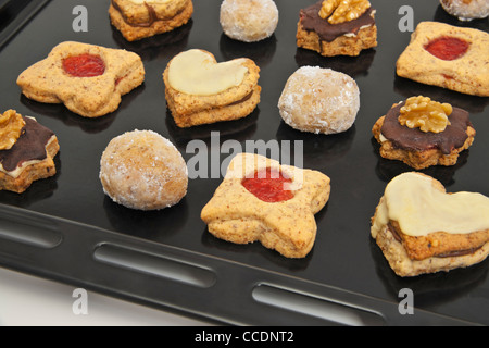 Detail photo of a baking tray with home-made Christmas biscuits - Stock Photo