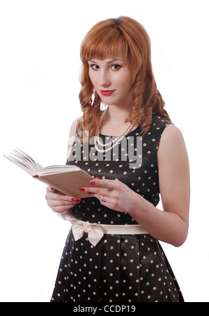 Retro girl with the book in the hands - Stock Photo