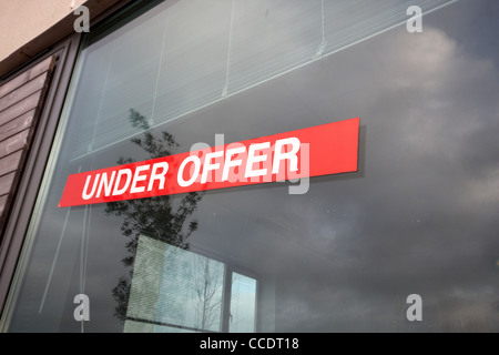 An under offer sign on a building for sale - Stock Photo