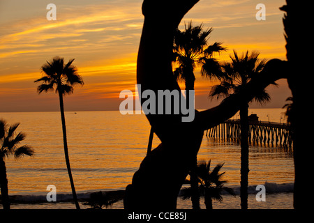 Sunset over the Pacific Ocean off the Californian coast at San Clemente pier. - Stock Photo