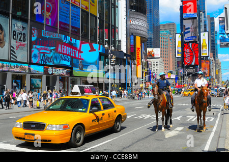 Mounted Police and Taxi in Times Square, New York City - Stock Photo