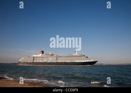 The Cunard liner Queen Victoria rounding Calshot Spit from Southampton Water - Stock Photo