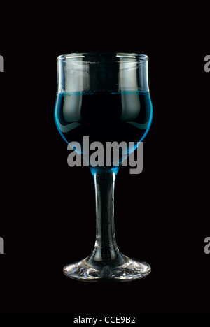 Blue wine on isolated black background - Stock Photo
