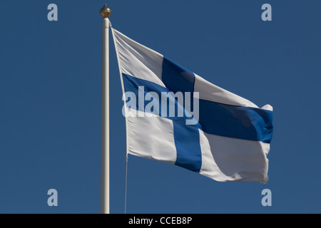 Finnish flag blowing in the wind - Stock Photo