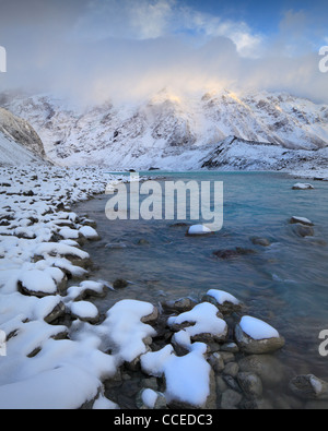 Clouds shroud Mt Sefton and The Footstool at sunrise as seen from the Hooker Valley in Mt Cook National Park, New - Stock Photo