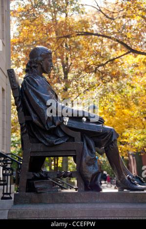 John Harvard's statue in Harvard University - Stock Photo