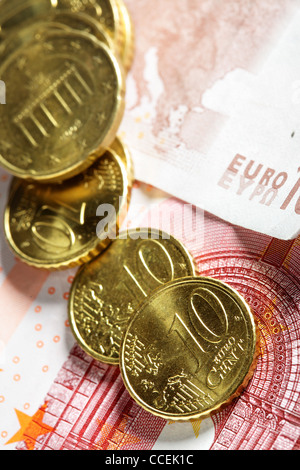 Heap of euro cent coins close up on banknote - Stock Photo