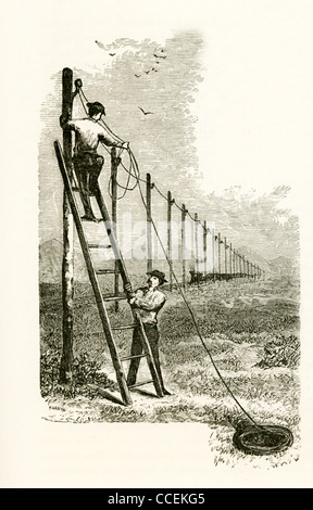 Samuel Morse was a major contributor to the invention of a single-wire telegraph system in 1838—two men hang telegraph - Stock Photo