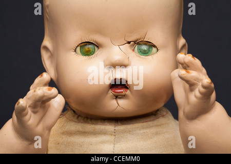 A scary-looking vintage infant doll. - Stock Photo