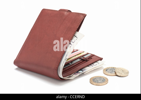 A brown leather wallet containing cards and British pounds - Stock Photo