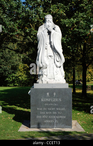 Confucius statue in the Chinese garden in the gardens of the world in Berlin. - Stock Photo