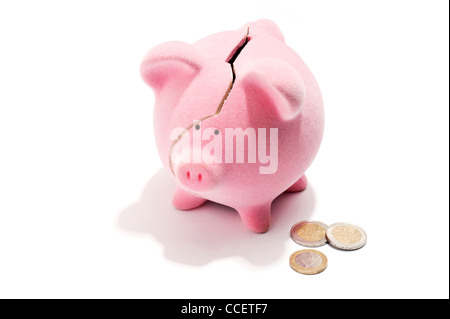 A broken piggy bank and euro coins - Stock Photo