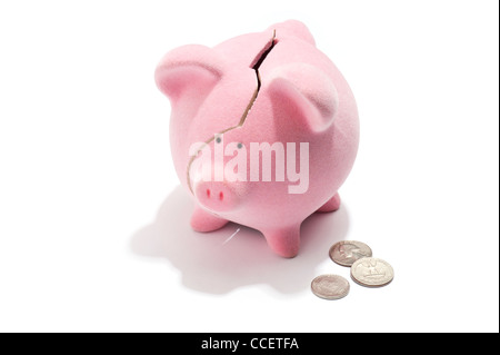 A broken piggy bank and American coins - Stock Photo