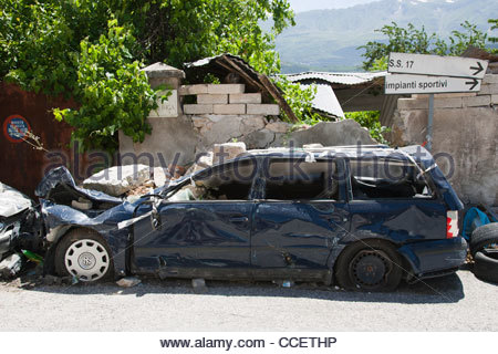 damaged car,earthquake,06 april 2009,st gregorio village,province of l'aquila,abruzzo,italy,europe - Stock Photo