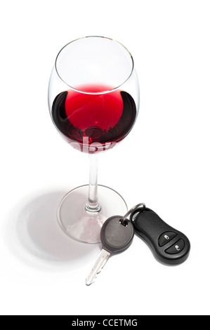 A glass of red wine and a car key - Stock Photo