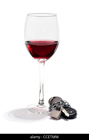 A glass of red wine and a car key chained and padlocked - Stock Photo