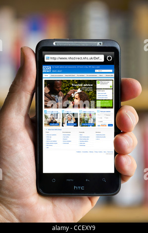 The NHS Direct health advice website viewed on an HTC smartphone, England, UK - Stock Photo
