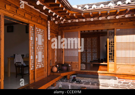 Traditional Korean House with timber frames and clay roof tiles in Bukchon Hanok Village, Seoul, Korea - Stock Photo