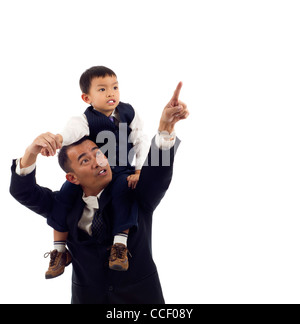 Portrait of an Asian Father pointing something interesting to his son isolated over white background - Stock Photo