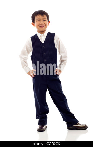 Full length portrait of a happy little Asian boy standing isolated over white background - Stock Photo
