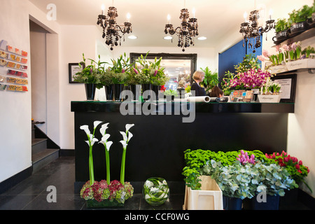 Woman working in florist shop - Stock Photo