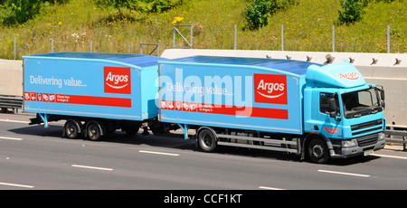 ide & front of Argos catalogue retail store business supply chain hgv lorry truck and towing trailer driving along - Stock Photo