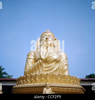 Abhaya Mudra Gesture Of Fearlessness of the Buddha in Wat Buppharam in George Town in Penang Island in Malaysia - Stock Photo