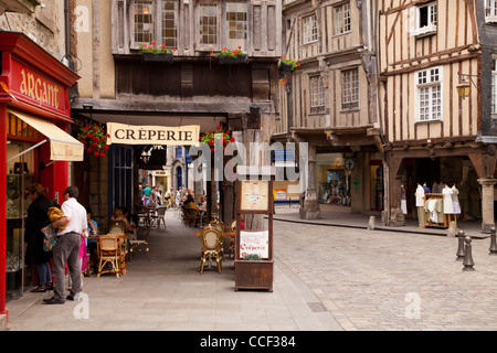 Shops, restaurants and ancient half timbered buildings in the medieval centre of Dinan, Brittany, France. - Stock Photo