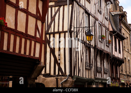 Medieval half timbered buildings in the walled town of Dinan, Brittany, France. - Stock Photo