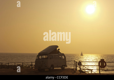 VW camper van parked on the seafront at dawn. Broastairs. Isle of Thanet. Kent. England. UK - Stock Photo