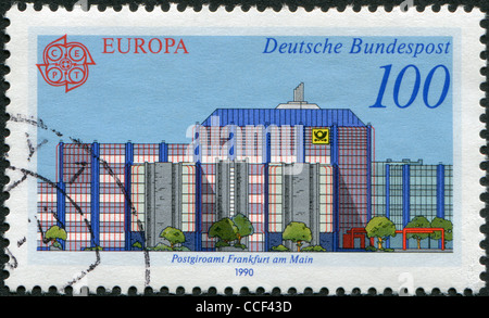 GERMANY - CIRCA 1990: A stamp printed in Germany, shows the Post offices in Frankfurt am Main: Modern Giro office, - Stock Photo