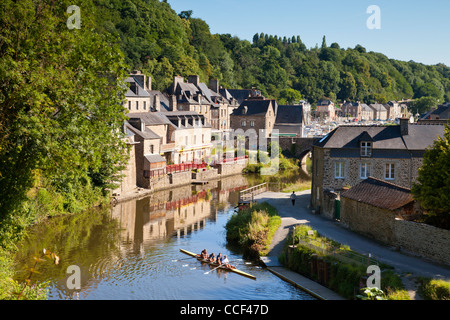 A four place skuller in the foreground of this image from Dinan, Brittany, France. The medieval port is one of the - Stock Photo