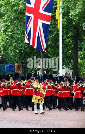 Brass band of members of Irish and Coldstream Guards marching along Pall Mall during Trooping the Colour, London - Stock Photo