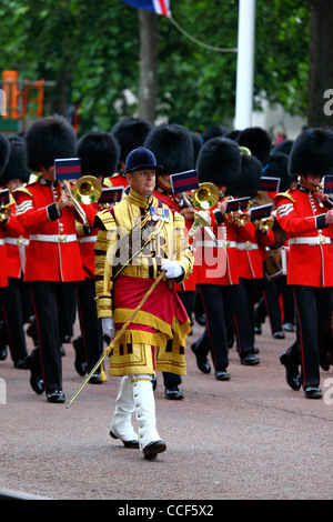 Bandmaster and brass band of Irish and Coldstream Guards march along Pall Mall during Trooping the Colour, London - Stock Photo
