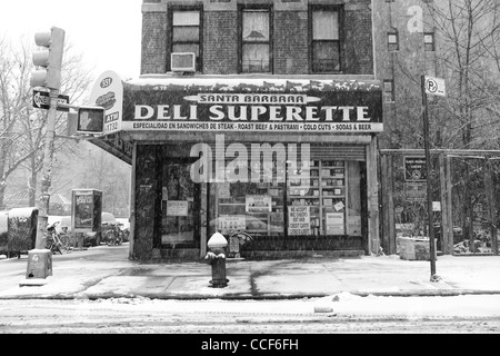January 21st 2012: Picture shows a delicatessen as snow is seen falliing in the east village downtown New York City, - Stock Photo