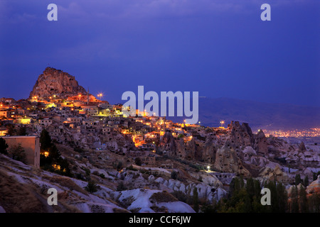 Beautiful Uchisar village with its spectacular rocky castle, at night. Nevsehir, Cappadocia, Turkey - Stock Photo