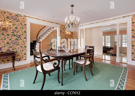 Dining room in luxury home with white columns - Stock Photo