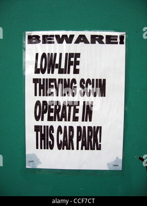 Low-life thieving scum warning at Langland Bay beach car park near Swansea. - Stock Photo