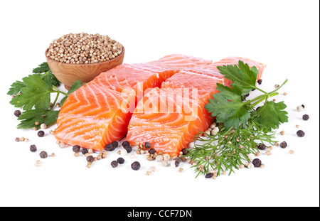 two slices trout fillet whith spices isolated on white background - Stock Photo