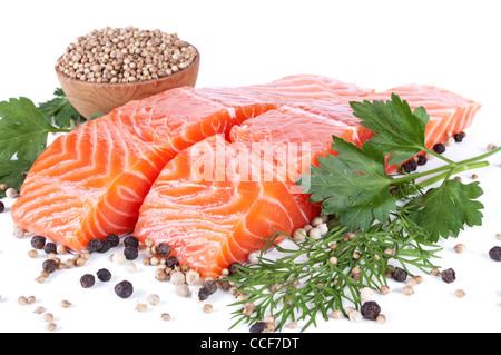 two slices trout fillet whith spices on white background - Stock Photo