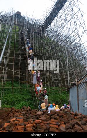 Workers and scaffolding on the The Abhayagiri Dagoba, Anuradhapura, Sri Lanka - Stock Photo