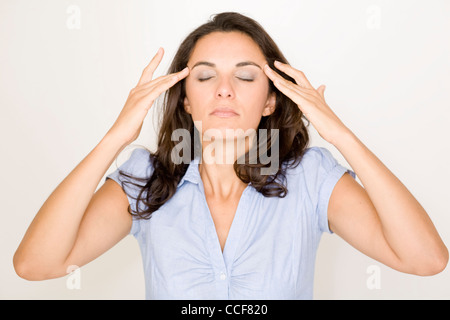 Latin woman suffering from headache - Stock Photo