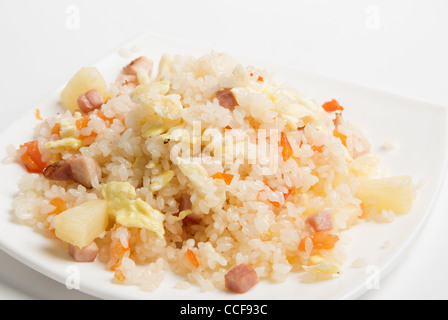 Rice with vegetable on a plate isolated over white - Stock Photo