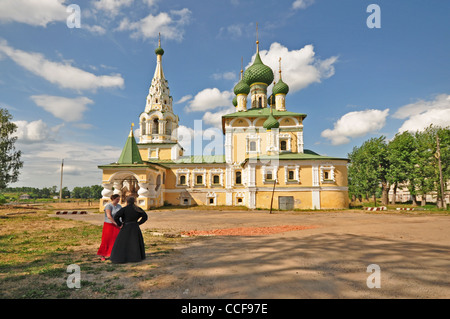 RUSSIA, Uglich, Russian Orthodox Church next to the Monastery of The Resurrection with priest and parishioner - Stock Photo