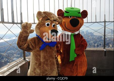 Dec. 16, 2010 - Manhattan, New York, U.S. - The Empire State Building hosts YOGI BEAR and BOO BOO to promote the - Stock Photo