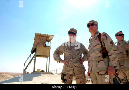 Jul 06, 2004; Baghdad, IRAQ; U.S. Airforce Lt. Gen. LANCE SMITH (C) talks with U.S. Marine Corps Maj. Gen. KEITH - Stock Photo